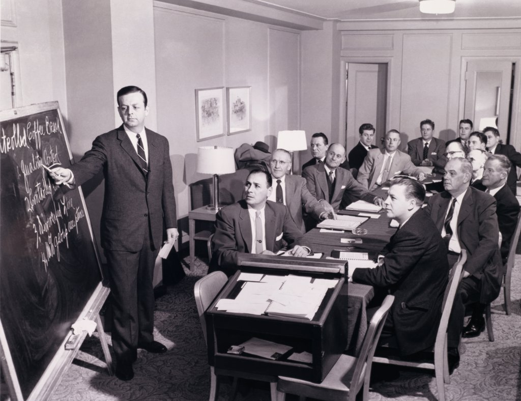 Stock Photo: 443-133 Businessman giving a presentation in a meeting, 1955