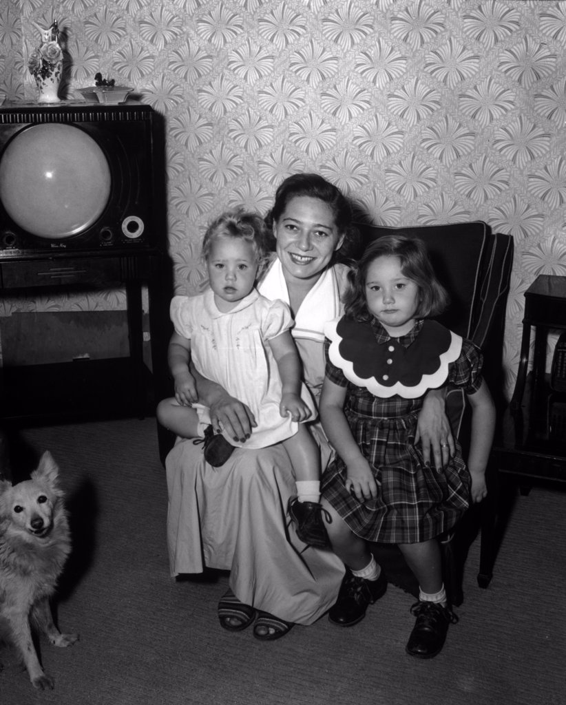 Stock Photo: 443-175 Portrait of a mother sitting with her two daughters, 1951