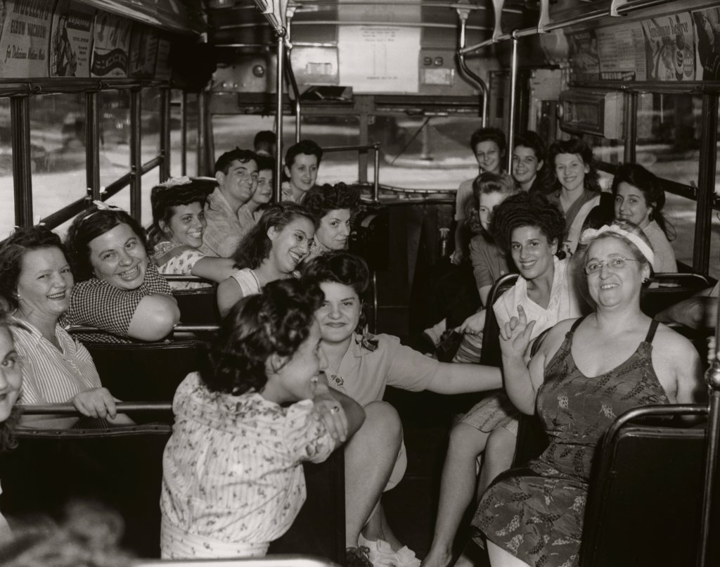 Stock Photo: 443-232 Passengers traveling in a bus, 1944