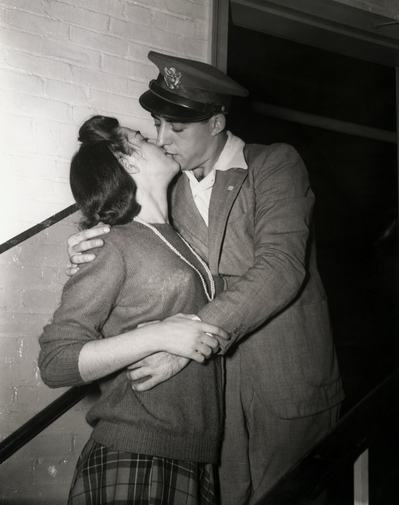 Young couple kissing, 1940 : Stock Photo