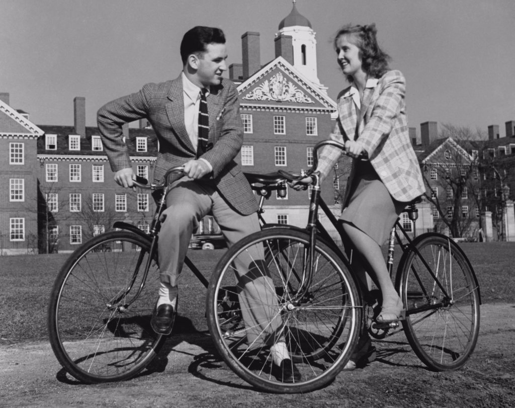 Stock Photo: 443-249 Young couple cycling on campus