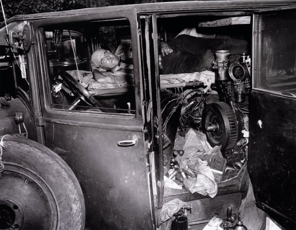Senior man sleeping in an abandoned car, 1941 : Stock Photo