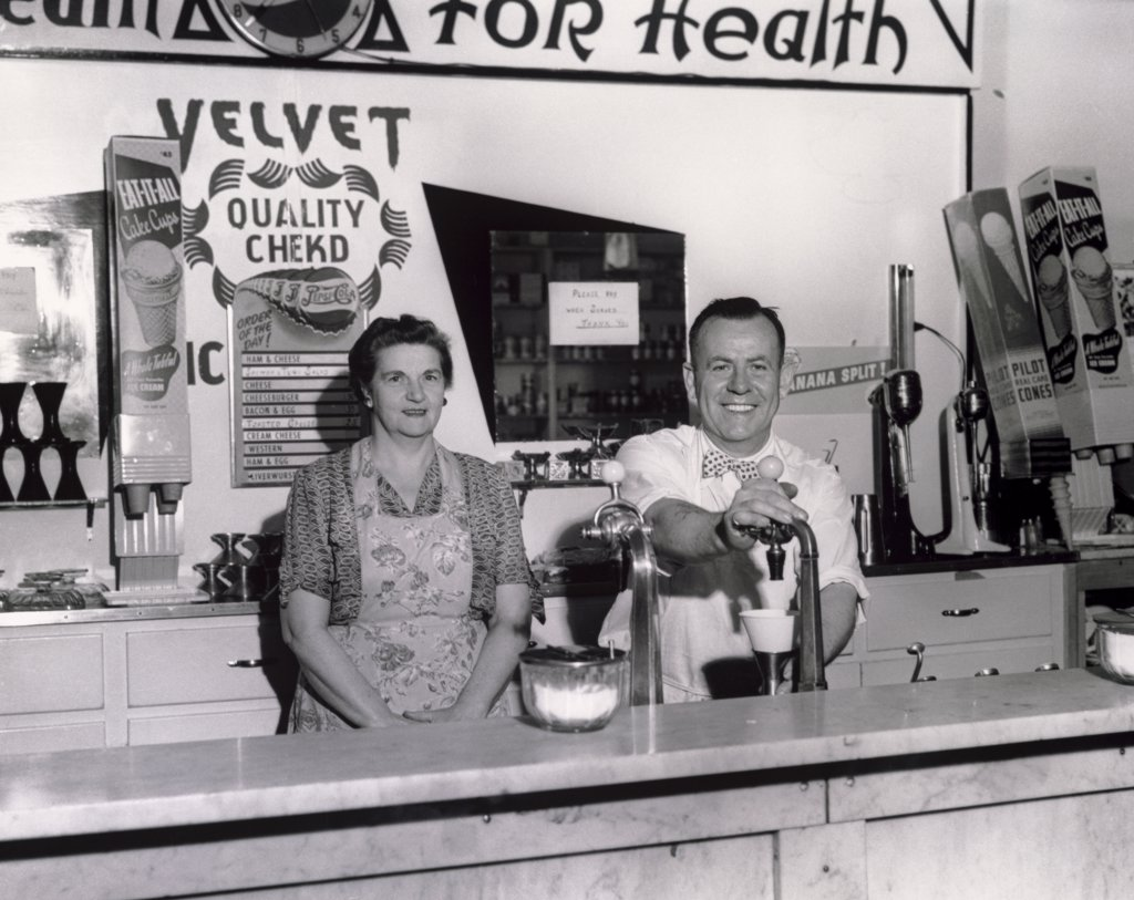 Stock Photo: 443-251 Portrait of a mature couple in a shop, 1951