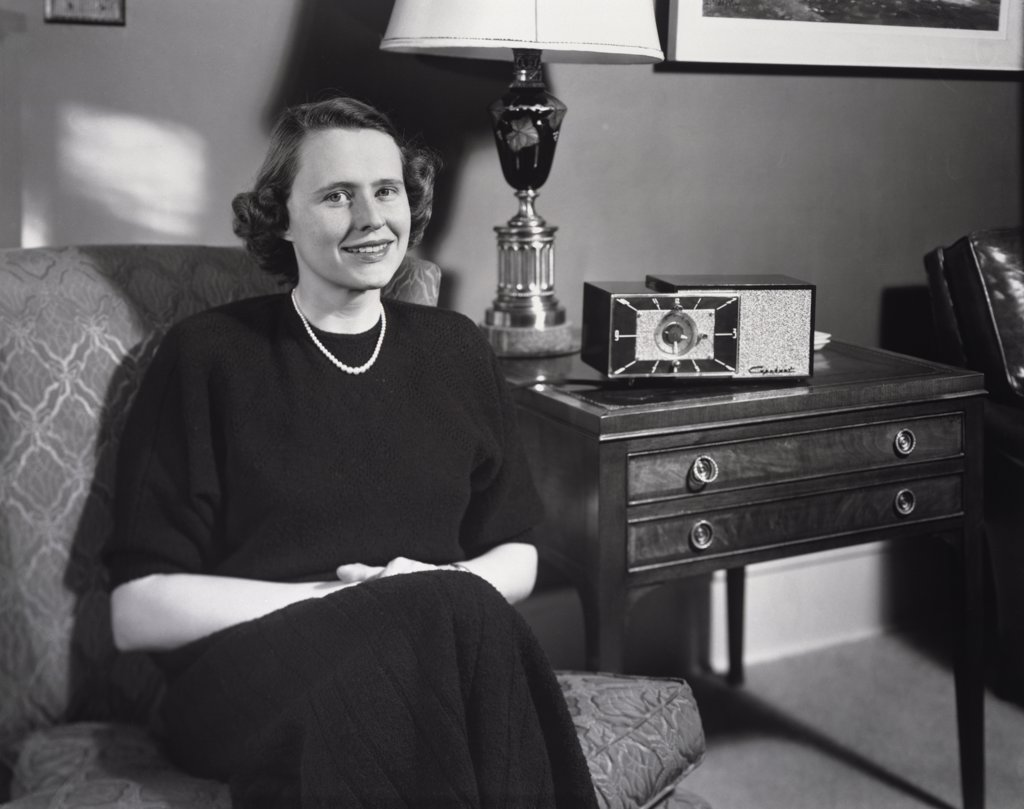 Portrait of a mature woman sitting on a couch, 1950 : Stock Photo