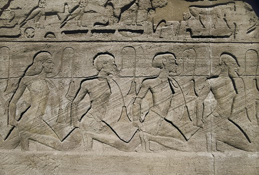 Stock Photo: 4435-3674 Great Temple of Rameses II. EGYPT. Abu Simbel. Great Temple of Rameses II. Entrance reliefs depicting the military victories of Pharaoh Ramesses II. Prisoners. Egyptian art. New Kingdom. Relief.