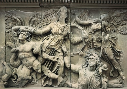 Stock Photo: 4435-4852 Great Altar of Zeus and Athena. ca.  180 -160 BC. Podium frieze with Gigantomachy scene. Athena takes the giant Alcyoneus by the hair while the goddess Gaia, mother of the giants, begs for his life (right lower part). A winged Victory gazes at the scene. Hellenistic art. Relief. GERMANY. BERLIN. Berlin. Pergamon Museum. Proc: TURKEY. MARMARA. IZMIR. Bergama. Pergamon.