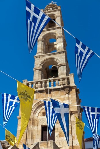 Greece, Rhodes, Lindos, Greek flags and tower : Stock Photo