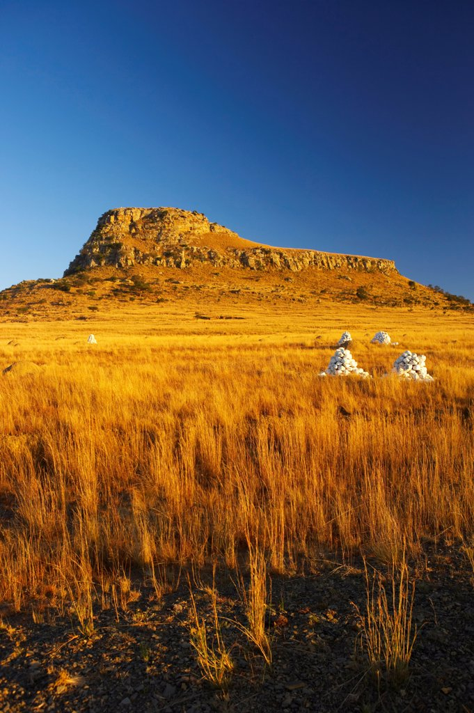 Stock Photo: 4441-4953 Cairns of white stones and memorials mark the places where British soldiers died at the Battle of Isandlwana during the Anglo Zulu War of 1879. Near Nqutu. kwaZulu-Natal. South Africa