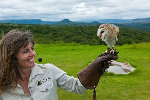 Stock Photo: 4441-9602 Shanon Hoffman with a Barn Owl (Tyto alba)  at the African Bird of Prey Sanctuary. Durban. KwaZulu Natal. South Africa.