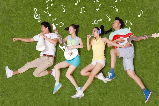 Stock Photo: 4445R-10925 Young people on grass playing musical instruments