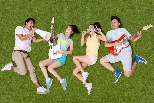 Stock Photo: 4445R-11010 Young people on grass playing musical instruments