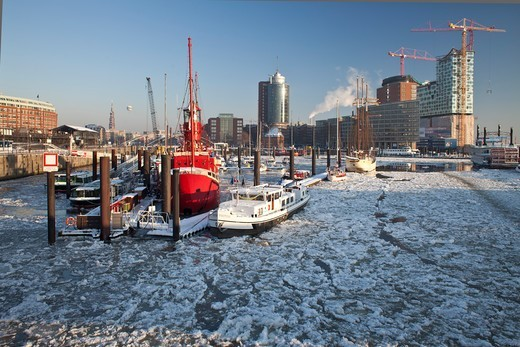 Stock Photo: 4449-53406 Fire ship in front of HTC Hanseatic Trade Center and Elbphilharmonie in winter, the Free and Hanseatic City of Hamburg, Germany, Europe