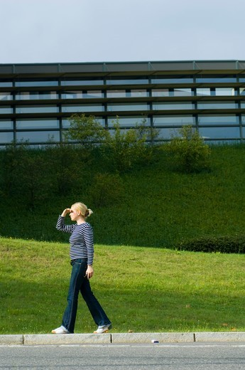Stock Photo: 4449-69499 Woman walking past modern building, Luxembourg