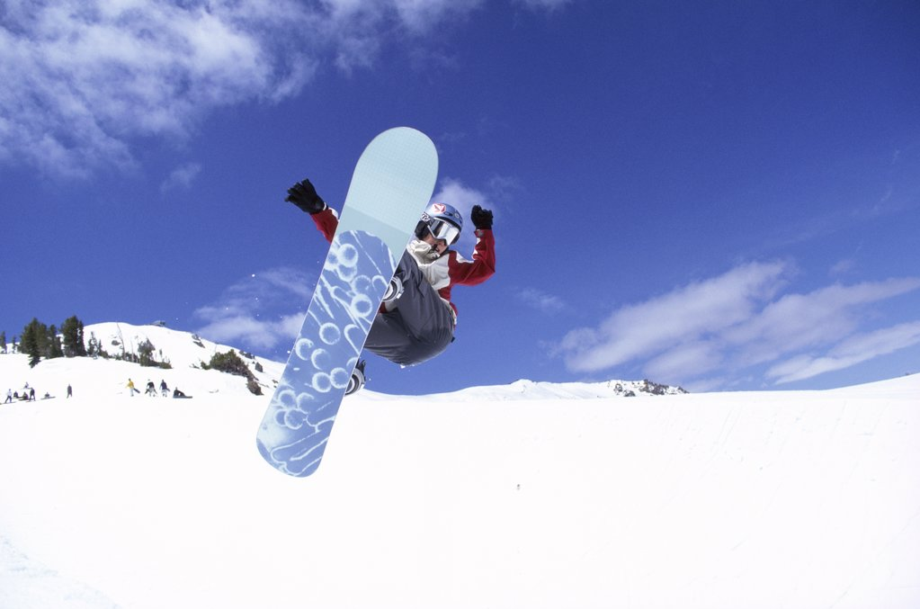Snowboarder in mid air, Mammoth Mountain Ski Area, California, USA : Stock Photo