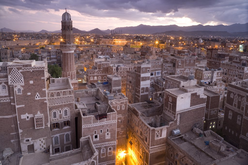Stock Photo: 4450R-21751060 High angle view over rooftops of buildings in the old city of Sana'a in Yemen. A UNESCO world heritage site with traditional architecture, houses of many storeys with decorative friezes.