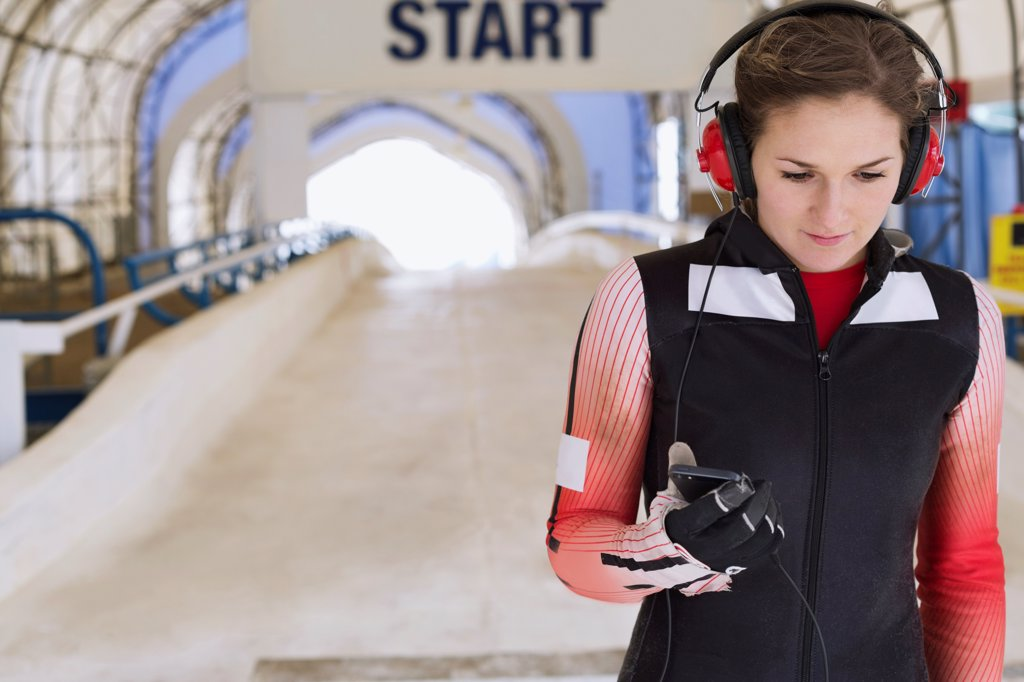 Stock Photo: 4451R-2140 Female skeleton athlete preparing for race