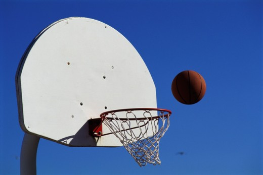 Stock Photo: 447-1393C Ball falls in basket
