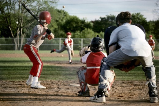Youth league baseball game : Stock Photo