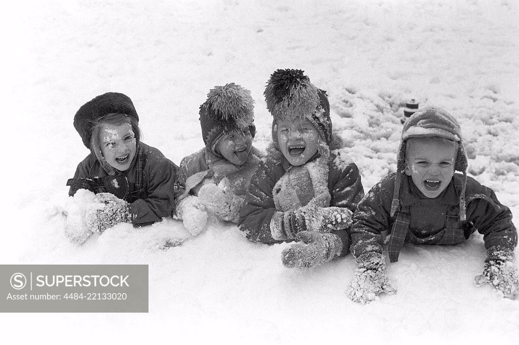 Stock Photo: 4484-22133020 Winter in the 1950s. Children are playing in a park in Stockholm. They don't seem to be freezing. Sweden 1954. Ref 2A-14