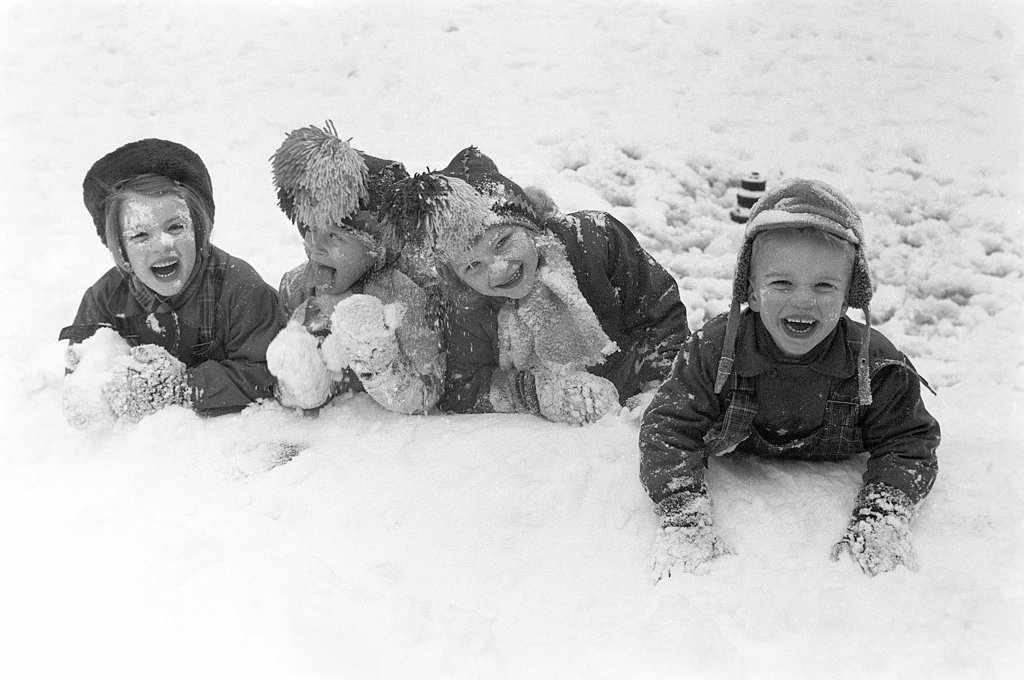 Stock Photo: 4484-22133018 Winter in the 1950s. Children are playing in a park in Stockholm. They don't seem to be freezing. Sweden 1954. Ref 2A-14