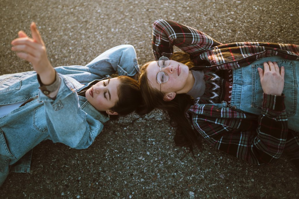Stock Photo: 4491R-22144098 Women couple lying on road