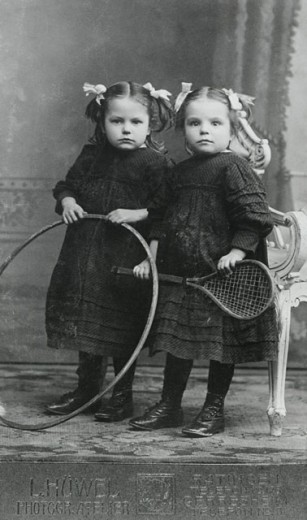 Portrait of two sisters holding a hoop and racket, Berlin, Germany, 1912 : Stock Photo