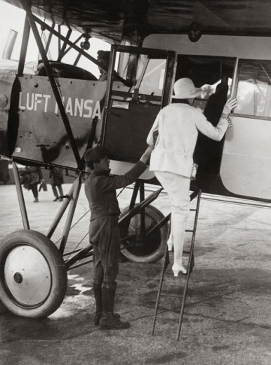 Stock Photo: 463-5805 Rear view of a woman boarding an airplane, Berlin, Germany, 1926