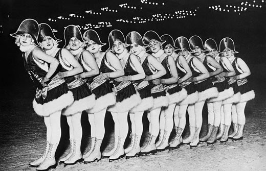 Group of ice skaters performing in a show, Berlin Sportpalast, Germany, c.1920 : Stock Photo