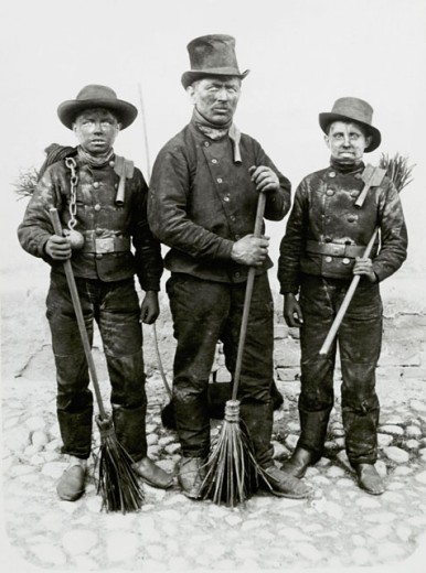 Stock Photo: 463-6084 Chimney sweeper with two apprentices standing with their brooms, Fraustadt, Germany, Circa 1915