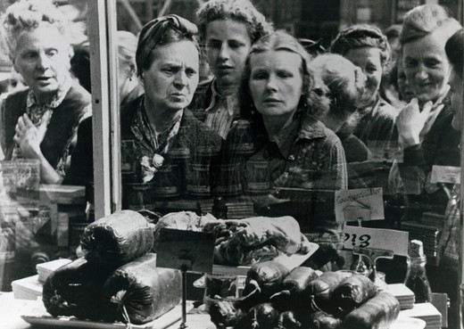 Stock Photo: 463-7297 Female shoppers gather outside a grocery store, Germany, June 1948