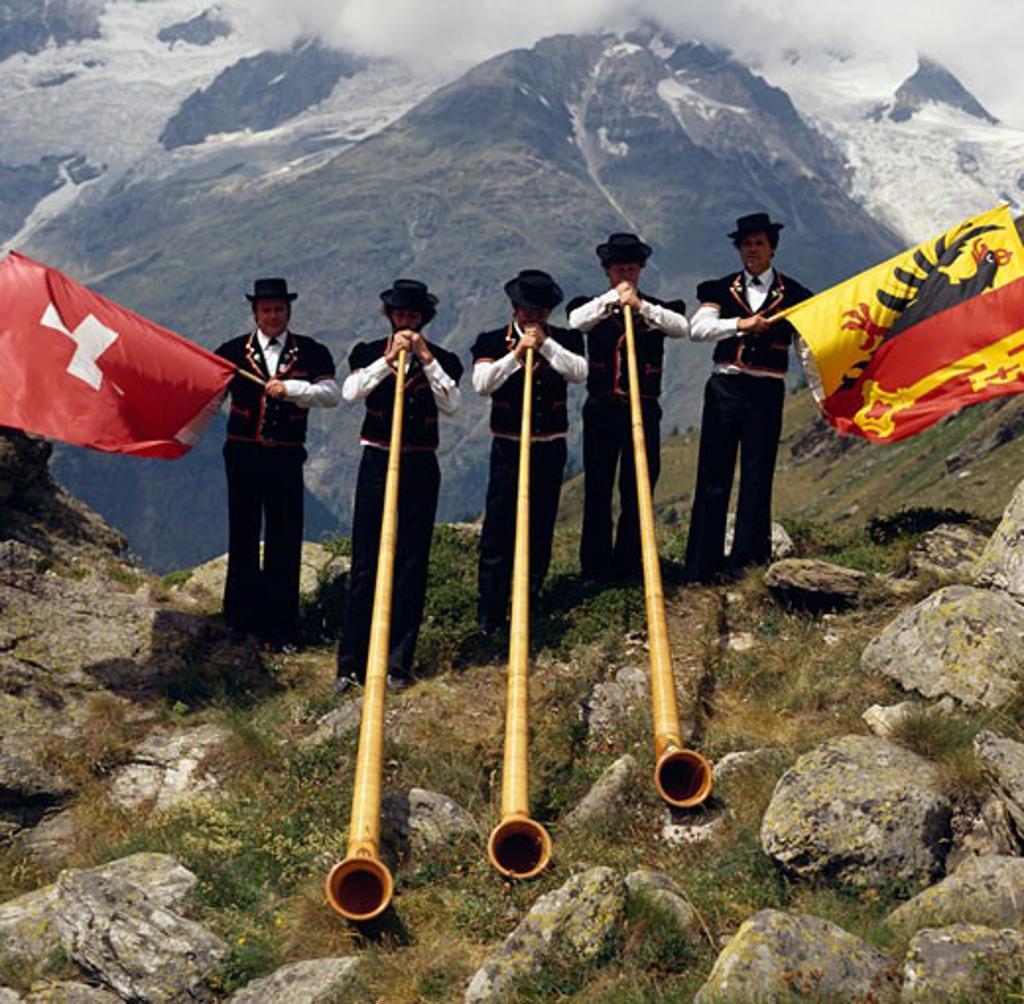 Stock Photo: 464-763 Switzerland,  Valais,  Taschalap,  Men playing on alphorns