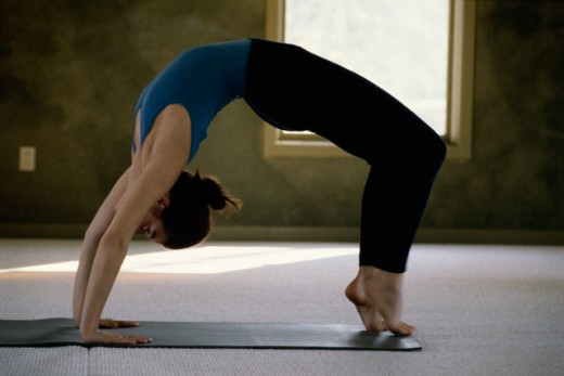 Woman performing yoga : Stock Photo