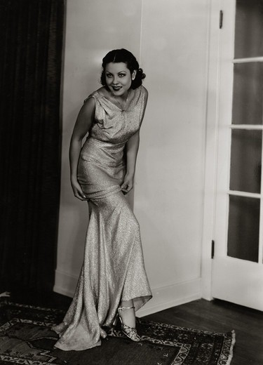 Stock Photo: 486-1725 Young woman posing in elegant dress, 1931