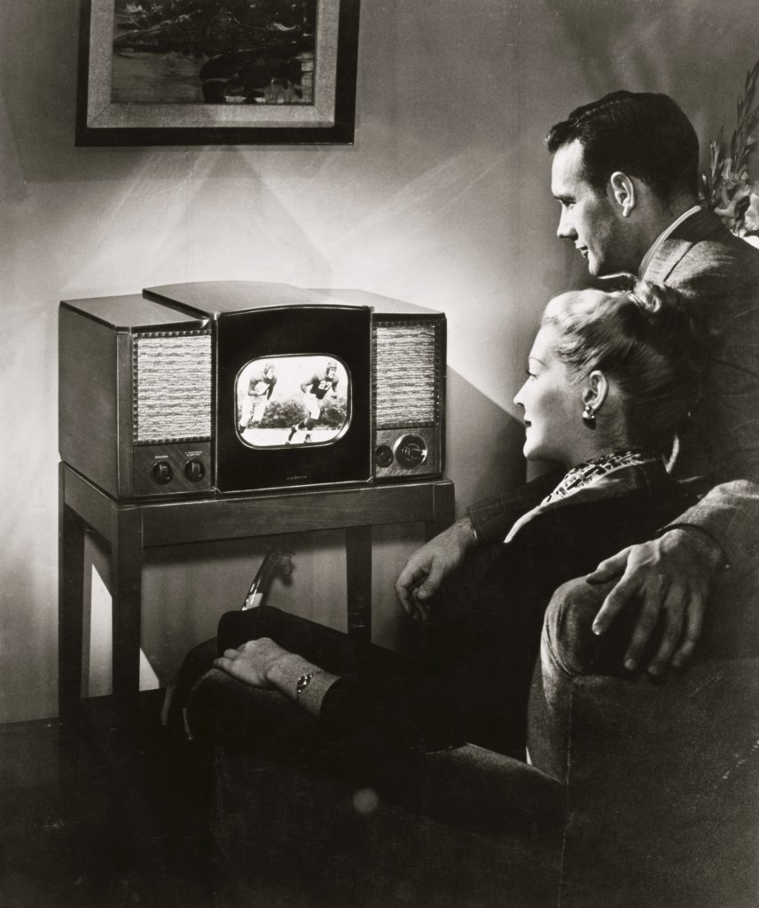 Stock Photo: 486-194 Young couple watching television in a living room, 1947
