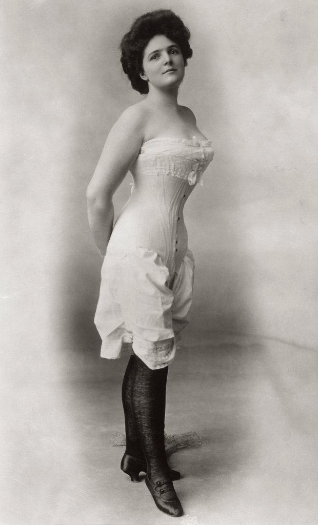 Young woman wearing a corset : Stock Photo