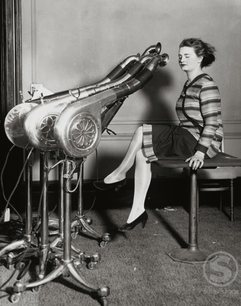 Stock Photo: 486-221 Side profile of a mid adult woman drying her hair, 1920