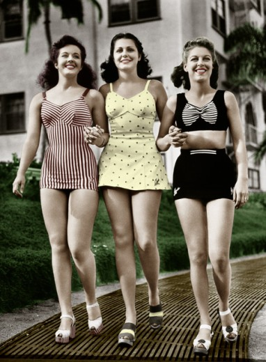 Three young women walking together : Stock Photo