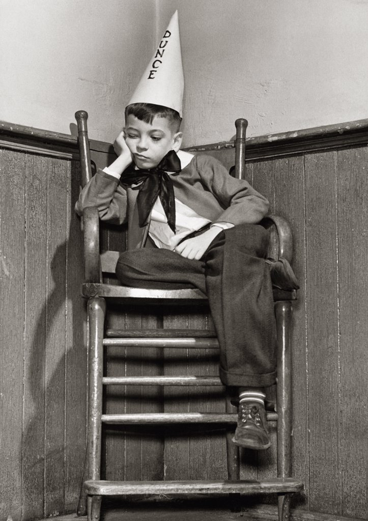 Stock Photo: 486-248 Low angle view of a boy wearing a dunce cap