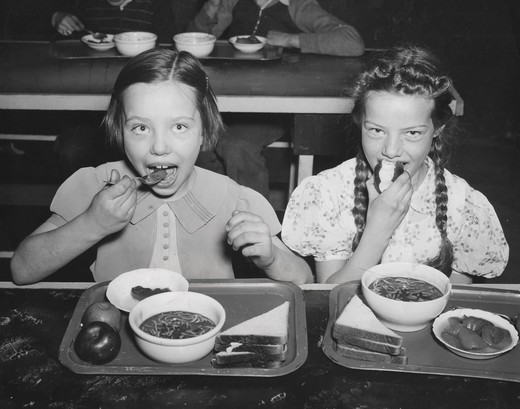 Stock Photo: 486-2658 Girls eating school meal