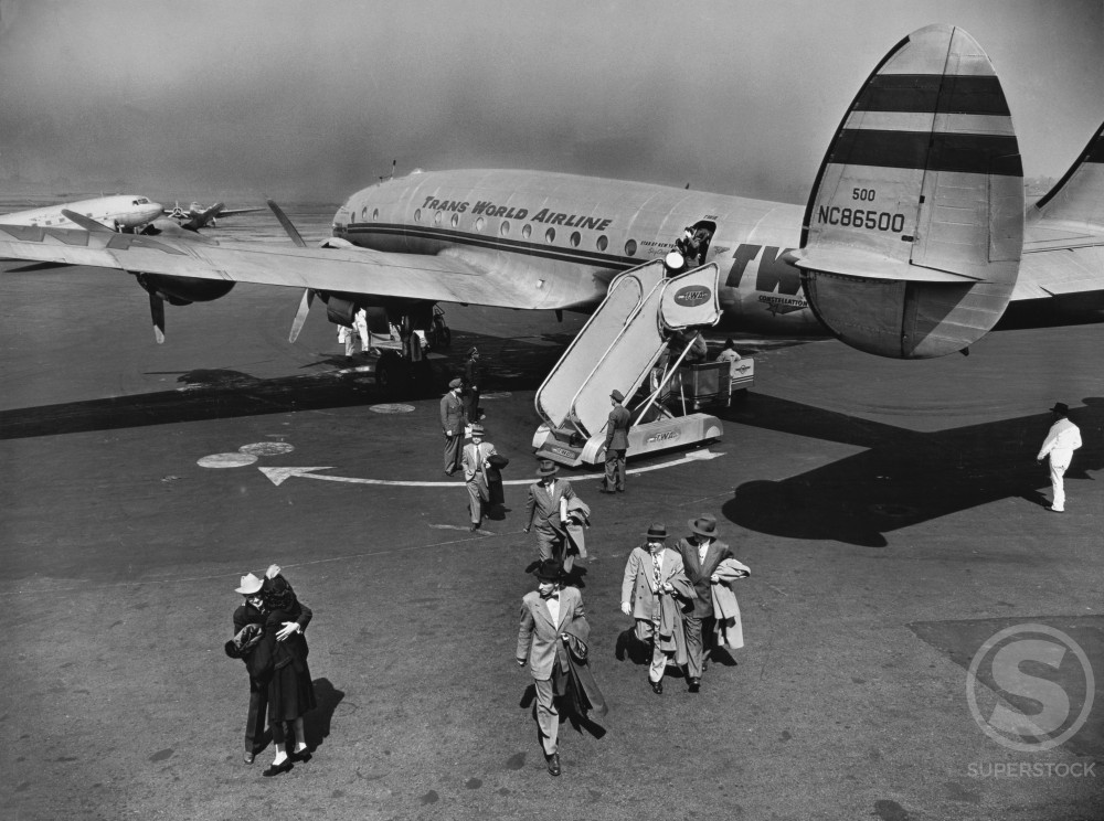 High angle view of passengers unloading off an airplane, Lockheed L-111 Constellation, LaGuardia Airport, New York City, USA, 1945 : Stock Photo