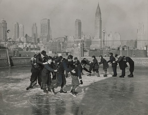 Stock Photo: 486-5563 USA, New York State, New York City, Madison Square Boys Club members skating on roof of Jack Frost's building, 1940