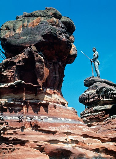 Person standing on a rock formation, Elcho Island, Arnhem land, Northern Territory, Australia : Stock Photo