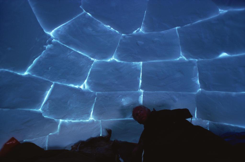 Stock Photo: 53-1424 An Eskimo inside an igloo, Ellesmere Island, Northwest Territory, Canada