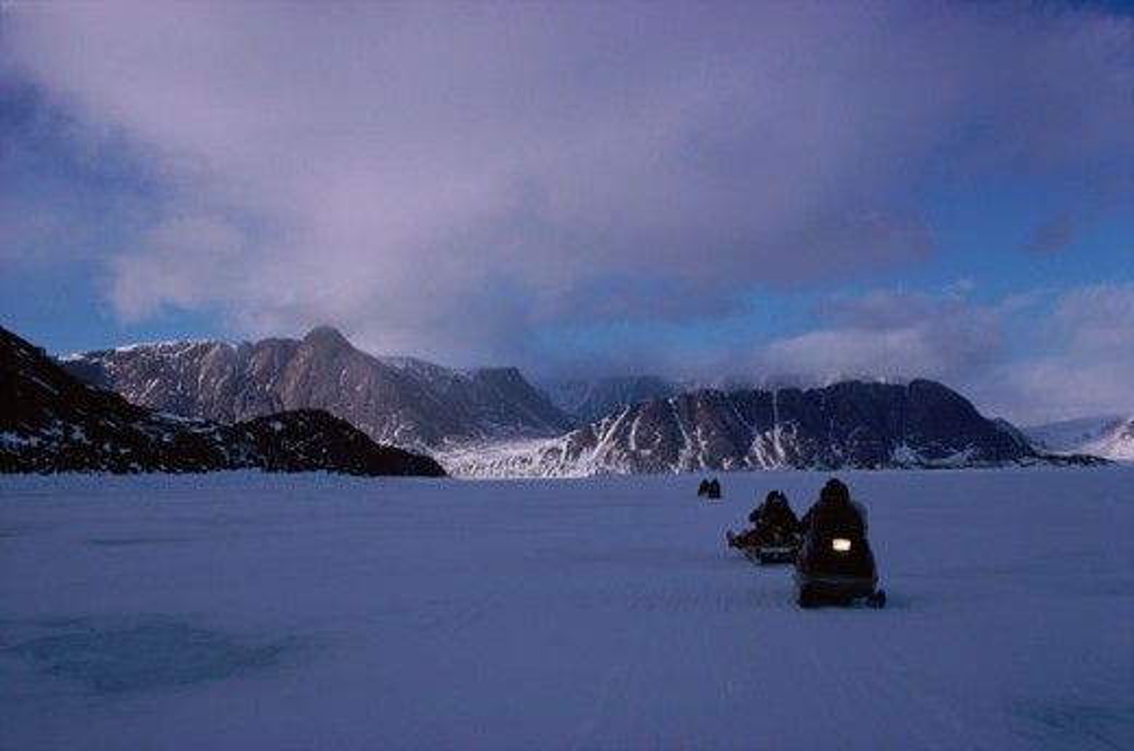 Stock Photo: 53-447 People riding snow mobiles, Arctic, Canada