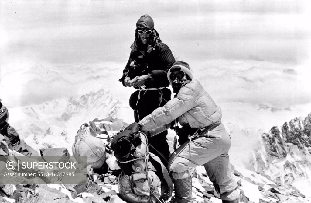 Stock Photo: 5513-16347985 This picture of Hillary and Tensing, resting on the South Col on their descent, shows the size of the packs they carried. June 29, 1953.
