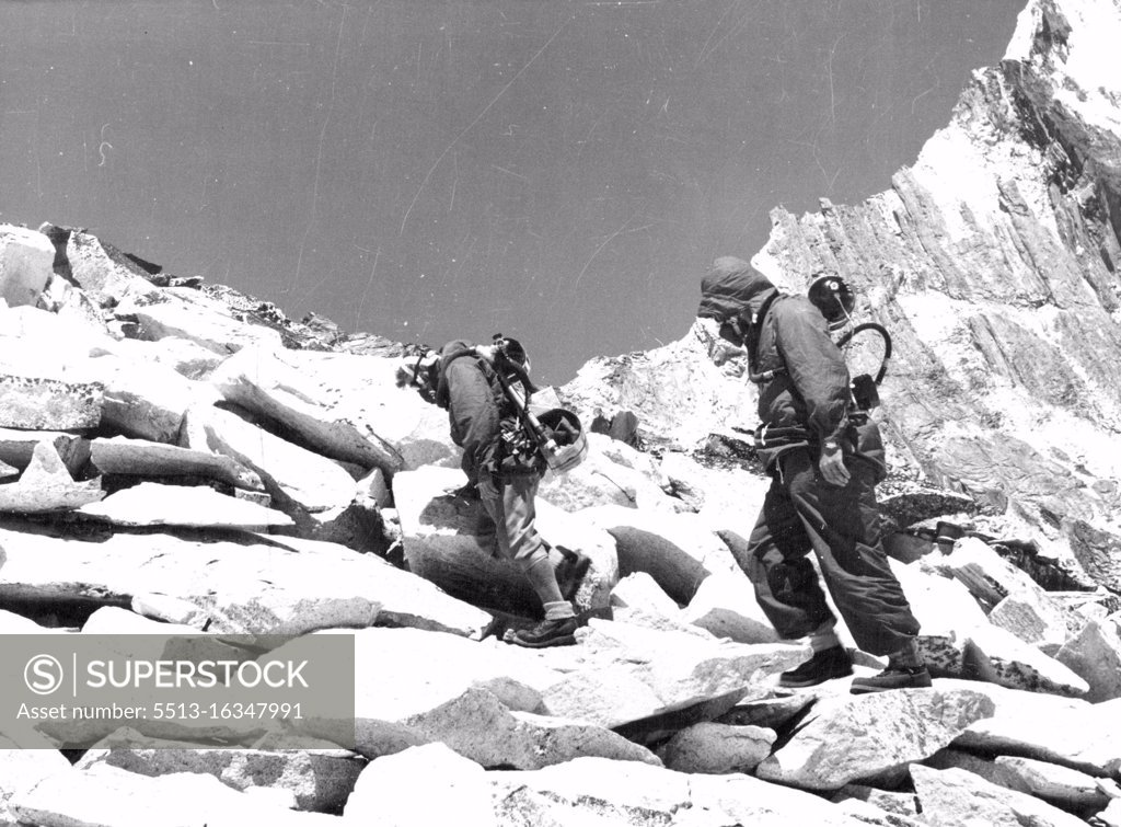 Stock Photo: 5513-16347991 British Everest 1953 Expedition -- R.C. Evans wearing closed circuit oxygen equipment and T.D. Bourdillon wearing open circuit apparatus, climbing the South West Ridge of Amadablam at 18,500ft. May 14, 1953.