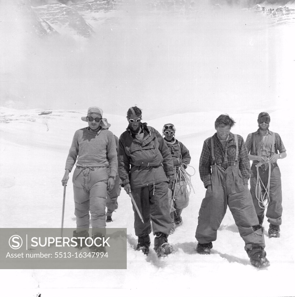 Stock Photo: 5513-16347994 British Everest 1953 Expedition -- E.P. Hillary (second from left) with Tensing behind on their way to the camp with other members of the expedition who came up from Camp IV to meet them above the South Col. June 19, 1953.