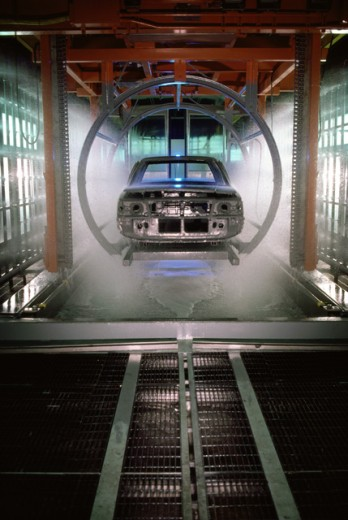 Washing Off Excess Rustproofing from Autobody : Stock Photo