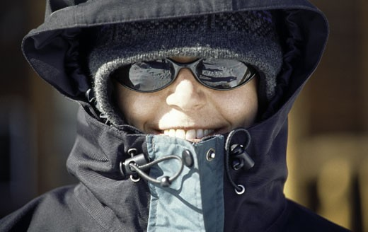 Close-up of a young woman wearing hood jacket : Stock Photo