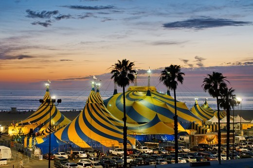 Stock Photo: 618-455 USA, California, Santa Monica, Striking blue and yellow tent tops of Cirque du Soleil, adorning Santa Monica Beach next to Santa Monica Pier, during their stay 2011 and 2012